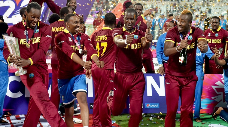 Kolkata: West Indies Captain D Sammy with teammates and trophy celebrates after beating England in the ICC World T20 final match at the Eden Gardens in Kolkata on Sunday. PTI Photo by Swapan Mahapatra (PTI4_3_2016_000324b)